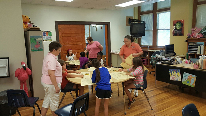 ECE faculty helping local children with camp activities