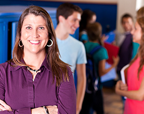 Lady smiling with students in the background